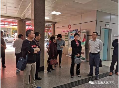 威信县人民龙8游戏到我院参观交流卒中中心建设